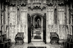 Ely Cathedral. Two Chairs either side of a door at Ely Cathedral royalty free stock photo