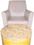 Chair and Table. Gray leather chair and round marble table Royalty Free Stock Image