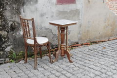 Chair and table  ancient at The background is the old wall Royalty Free Stock Images