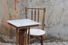 Chair and table  ancient at The background is the old wall Royalty Free Stock Photo