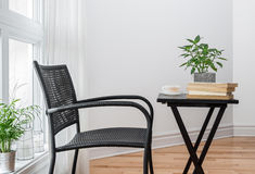 Chair and table with books to read Stock Photos