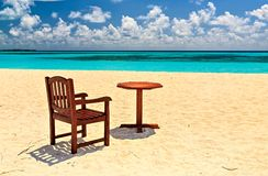 Chairs and table are on the beach royalty free stock photos