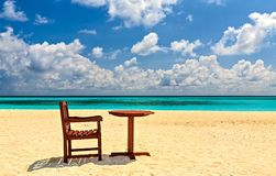 Chairs and table are on the beach stock photography