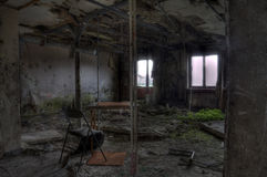 Chair and table in destroyed room Stock Image