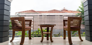 Chair and Table on House Patio. Garden stock image
