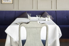 Chair and table setting at restaurant. Stock Image