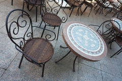 Chair and Table in Street Cafe. Wattled chair and mosaic table in street cafe stock photos
