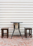 Two chair and a table on wood background Royalty Free Stock Photography