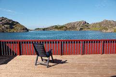 A chair on the terrace. A chair on the wooden teracce at the cabin with the magma park view stock image
