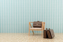 Chair and three portfolio. Three leather portfolio in the room Stock Photography