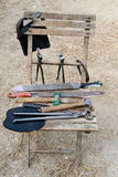Chair with tools. Chair with farrier job tools Royalty Free Stock Photo