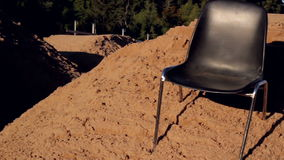 Chair at the tops of heaps of soil Royalty Free Stock Image