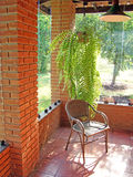 Chair and tree on countryhouse. Porch stock photo