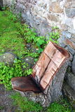 Chair of a tree trunk. Chair carved from a tree trunk Royalty Free Stock Photo
