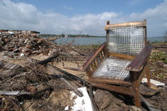 Chair in Tsunami Debris. January 13, 2005 - A chair sits among the debris left after the tsunami hit Batticaloa, Sri Lanka, which was devastated by the force of Stock Image