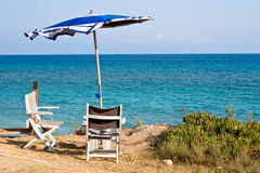 Chair and umbrella Royalty Free Stock Images