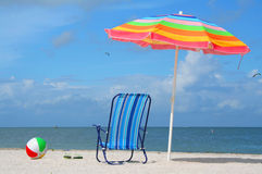 Chair, Umbrella And Ball At The Beach Royalty Free Stock Images