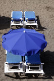 Chair and umbrella on beach Stock Image