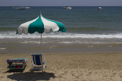 Chair and umbrella on the beach. Scenes with chair and sea on the beach Royalty Free Stock Images