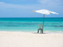 Chair and umbrella on the beach Royalty Free Stock Image