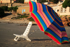 Chair and umbrella on the beach at sunset stock photos
