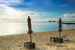 Chair and Umbrella on the beach Stock Photography