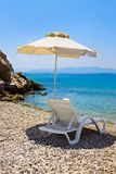 Chair and umbrella at greek beach Royalty Free Stock Photography