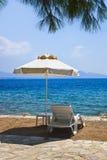 Chair and umbrella at greek beach Royalty Free Stock Photo