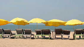 Chair with umbrella. Near the Beach stock video footage
