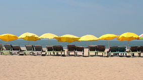 Chair with Umbrella near the Beach. Chair with yellow Umbrella near the Beach stock video footage