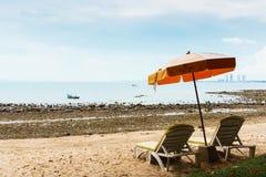 Chair and umbrella on ocean beach Stock Photography