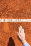 Chair Umpire check ball mark. Ball is IN. Stock Photo