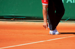 Chair umpire at Roland Garros 2011. An official in Roland Garros 2011 (game between Tomas Berdych and Stephane Robert), showing the line. The ball was safe Stock Image