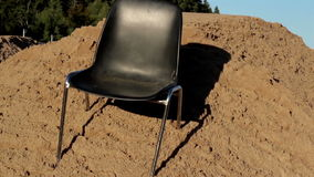 A chair under the heat of the sun Royalty Free Stock Photos