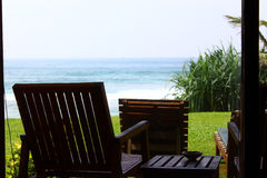 Chair on the veranda overlooking the Indian ocean Stock Photo