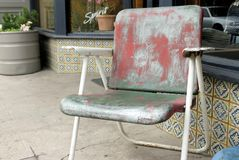 The Chair. This vintage chair which was probably painted red was on the street in Santa Fe, NM Stock Image