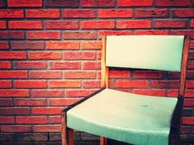 A chair at a wall Royalty Free Stock Images