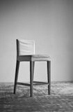 Chair on wall background Royalty Free Stock Image