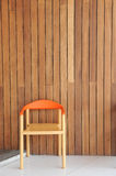 Chair and wall in background Stock Image