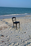 A Chair Washed Up on a Florida Beach Stock Images