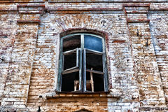 Chair in a window. Old house prepares for reconstruction. Residents threw old things in the house Stock Photo