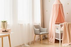 Chair by windows and crib royalty free stock photos