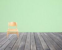 Chair on wood floor and wall paper background.  Royalty Free Stock Images