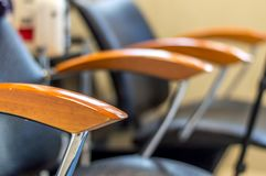 Chair with wooden armrests in beauty salon Royalty Free Stock Photo
