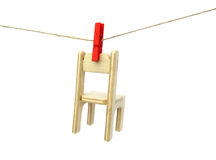 Chair wooden drying on clothes line Stock Photo
