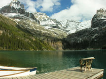 Chair on a wooden pier, Lake O'Hara, Yoho National Park, Canada. Chair on a wooden pier, Lake O'Hara, Yoho National Park, British Columbia, Canada Stock Images