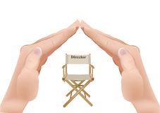 Chair with writing director. Hands in the shape of the roof chair cover of the Director Stock Photo