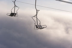 Chairlift above the clouds Stock Photography