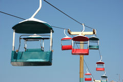 chairlift against blue sky Stock Photo