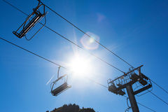 Chairlift against sun Royalty Free Stock Images